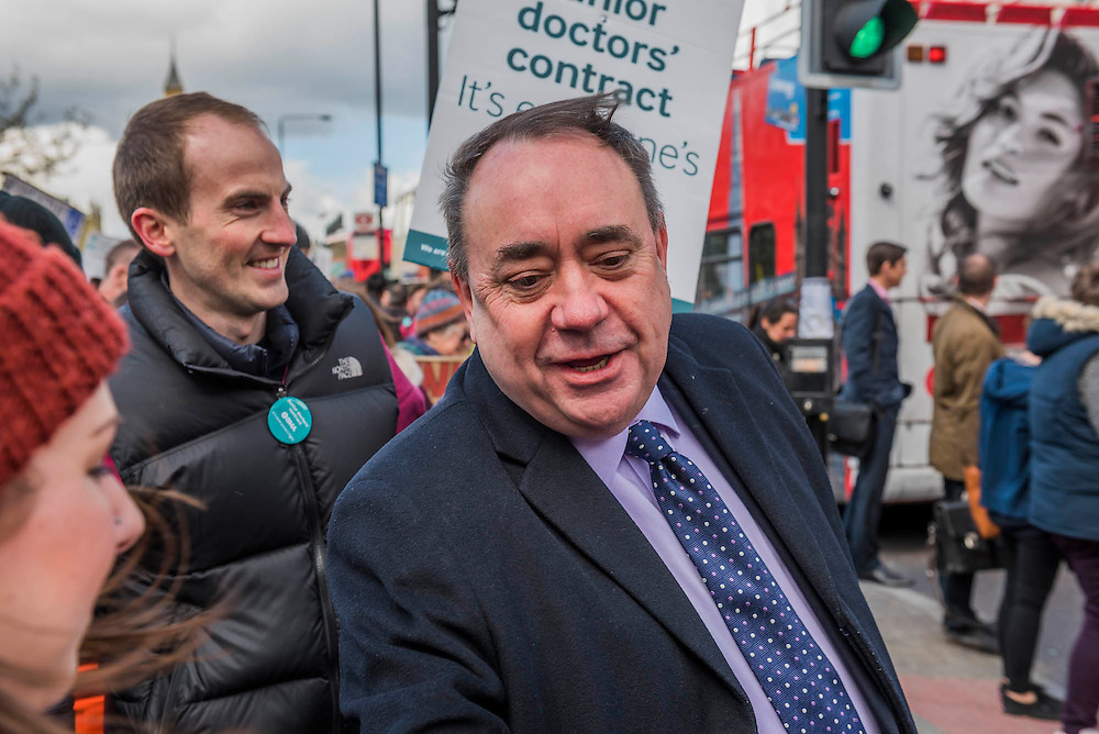 Alex Salmond, SNP MP, talks to doctors on his way to an appearanc eon the daily politics show - The picket line at St Thomas' Hospital. Junior Doctors stage a 7 day all out strike action, this time imncluding accident and emergency coverage. They are striking against the new contracts due to be imposed by the Governemnt and health minister Jeremy Hunt. They are supported by the British Medical Association.