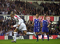 Photo. Glyn Thomas<br />England v Croatia - international friendly.<br />Portman Road, Ipswich. 20/08/2003.<br />England's David Beckham (L) celebrates scoring the first half penalty while Boris Zivkovic and Milan Rapaic look on in disappointment.