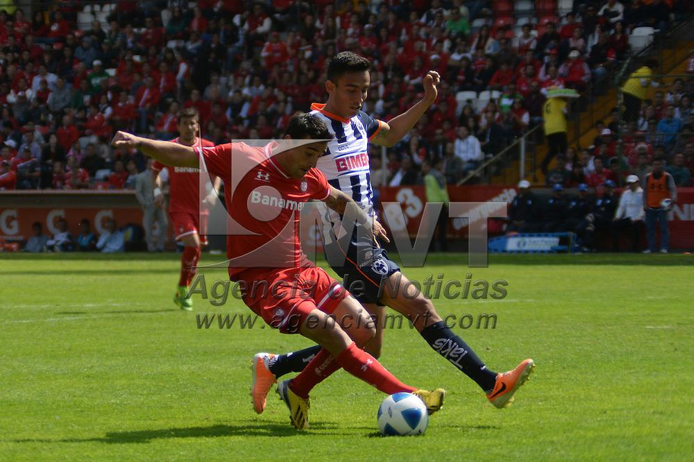 Toluca, México.- Juan M. Salgueiro durante el encuentro disputado entre los Diablos Rojos del Toluca y Rayados de Monterrey, con marcador de 2-0 a favor del equipo escarlata, correspondiente a la jornada 4 del Torneo de Clausura 2014. Agencia MVT / Crisanta Espinosa