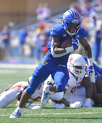 Sep 15, 2018; Lawrence, KS, USA; Kansas Jayhawks running back Pooka Williams Jr. (1) runs the ball during the first half against the Rutgers Scarlet Knights at Memorial Stadium. Mandatory Credit: Denny Medley-USA TODAY Sports