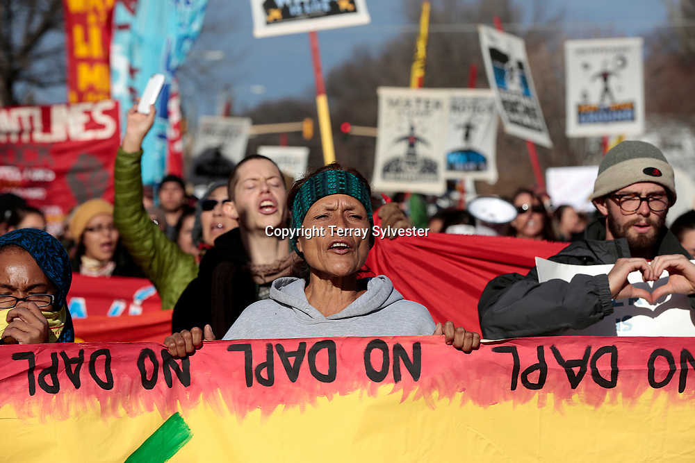 Dolores Moreno (center) of the Juañeno Band of Mission Indians in California holds a banner during a rally against the Dakota Access oil pipeline on the North Dakota state capitol grounds on November 14, 2016. Bismarck, North Dakota, United States.