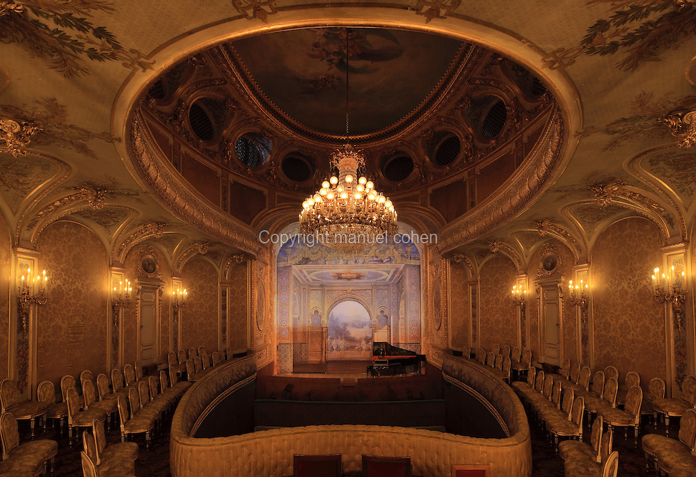 """Theatre Imperial Napoleon III de Fontainebleau (Fontainebleau Theatre Napoleon III), 1853-1856, by Hector Lefuel, fade lit by the original lightings of the 19th century, Fontainebleau, Seine-et-Marne, France. Restoration of the theatre began in Spring 2013 thanks to an agreement between the Emirate of Abu Dhabi and the French Governement dedicating 5 M€ to the restoration.  In recognition of the sponsorship by the Emirate of Abu Dhabi, French Governement decided to rename the theatre as """"Theatre Cheikh Khalifa bin Zayed Al Nahyan"""" (Cheikh Khalifa bin Zayed Al Nahyan Theatre). The achievement of a first stage of renovation will allow the opening of the theatre to the public on May 3, 2014. Picture by Manuel Cohen"""