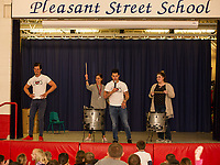 """Ryan Vezina and Justin Spencer of Recyled Percussion bring Porcia Magdziasz and Maggie Dehm on stage for a """"drum off"""" during their visit to Pleasant Street School Friday afternoon.  (Karen Bobotas/for the Laconia Daily Sun)"""
