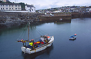 AF4WH6 Fishing boat Porthleven harbour Cornwall England