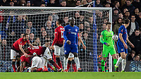 Football - 2018 / 2019 Emirates FA Cup - Fifth Round: Chelsea vs. Manchester United <br /> <br /> Manchester United players celebrate Paul Pogba (Manchester United) scoring his teams second goal as Chelsea players trudge back to their positions at Stamford Bridge<br /> <br /> COLORSPORT/DANIEL BEARHAM
