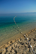Mooring line and buouy, beach at Zlatni Rat, near Bol, island of Brac, Croatia