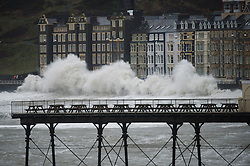 "Aberystwyth Wales UK,  Saturday 08 Feb 2014<br /> <br /> Gale force winds and big waves strike the sea walls at high tide at Aberystwyth on the west wales coast. The tides are relatively small, some 2m lower than the spring tides that brought  devastation to the town in early January.<br /> <br /> Winds gusting up to 70 or 80 mph were reported, bringing  potential disruption to transport and local power supplies. An amber ""be prepared"" warning  has been issued by the Met Office for wind, while a lower yellow warning for rain is in place until Sunday.<br /> <br /> photo ©keith morris"