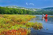 Canoeing on Killarney Lake and white quartzite rock of the La Cloche Hills <br />Killarney Provincial Park<br />Ontario<br />Canada