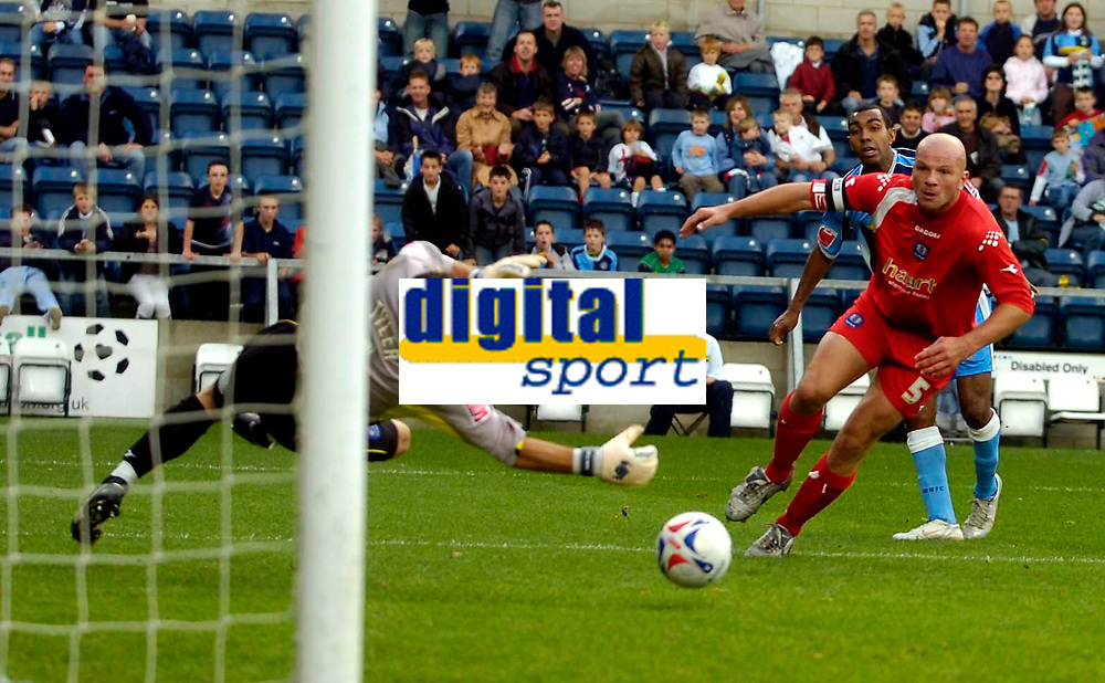Photo: Alan Crowhurst.<br />Wycombe Wanderers v Peterborough United. Coca Cola League 2. 21/10/2006. Wycombe's Kevin Betsy (hidden) watches his shot just go wide.
