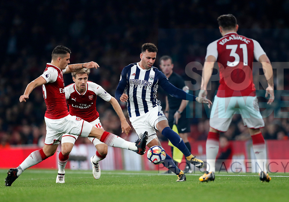 Arsenal's Granit Xhaka tussles with West Brom's Hal Robson-Kanu during the premier league match at the Emirates Stadium, London. Picture date 25th September 2017. Picture credit should read: David Klein/Sportimage