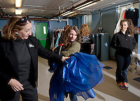 Stormy Leroux of Laconia gets assistance picking out her prom dress from Faith, Hope and Love volunteer Kate Wheeler-Smith during the 5th annual Gowns for Girls event held at Franklin Community Center Saturday afternoon.  (Karen Bobotas/for the Laconia Daily Sun)