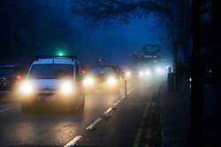 © Licensed to London News Pictures. 07/12/2020. London, UK. Traffic in dense fog in north London. Freezing cold and foggy weather is forecast across many parts of the UK. Photo credit: Dinendra Haria/LNP