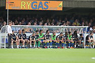 AFC Wimbledon bench during the EFL Sky Bet League 1 match between AFC Wimbledon and Oldham Athletic at the Cherry Red Records Stadium, Kingston, England on 21 April 2018. Picture by Matthew Redman.