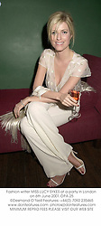 Fashion writer MISS LUCY SYKES at a party in London on 6th June 2001.OPA 25