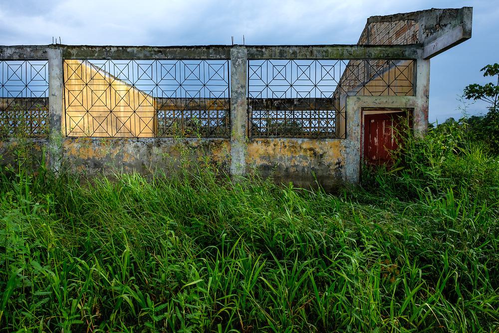 LORETO, PERU - CIRCA OCTOBER 2015:  Abandoned building around the Yarapa river. Village of Puerto Miguel in the Peruvian Amazon.