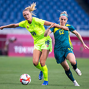 TOKYO, JAPAN - JULY 24: Fridolina Rolfo #18 of Sweden and Ellie Carpenter #12 of Australia challenge for the ball during the Australia V Sweden group G match at Saitama Stadium at the Tokyo 2020 Summer Olympic Games on July 24, 2021 in Tokyo, Japan. (Photo by Tim Clayton/Corbis via Getty Images)