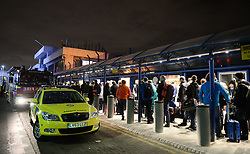 Emergency services outside London City Airport which has been closed as dozens of passengers were treated for breathing difficulties after a suspected chemical incident at the airport.