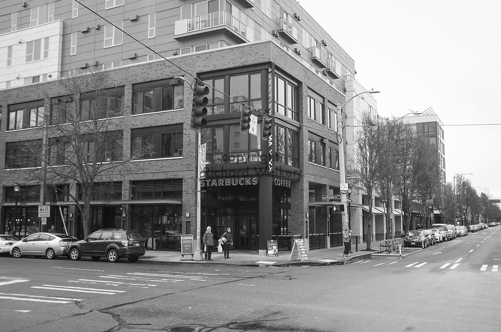 2017 MARCH 05 - Starbucks coffee at intersection of Alaska Street and California Ave SW in the Alaska Junction, West Seattle, WA, USA. By Richard Walker