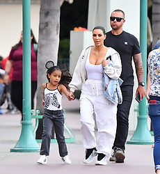 ** PREMIUM EXCLUSIVE RATES APPLY ** Kim Kardashian and her daughter North West have a fun day at Disneyland with friends. Kim was seen celebrating her best friend's daughter's birthday. The happy group were seen enjoying a ride on It's a Small world and met with Mickey Mouse in Toon Town before heading to lunch at a Mexican restaurant. Kim and Nori were seen leaving after only being at the park for about an hour and a half, leaving just before a strong rain storm ***SPECIAL INSTRUCTIONS*** Please pixelate children's faces before publication.***. 22 May 2019 Pictured: Kim Kardashian and North West. Photo credit: Marksman/ Snorlax / MEGA TheMegaAgency.com +1 888 505 6342