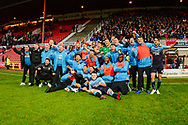 The Woking players  celebrate victory during the The FA Cup 2nd round match between Swindon Town and Woking at the County Ground, Swindon, England on 2 December 2018.