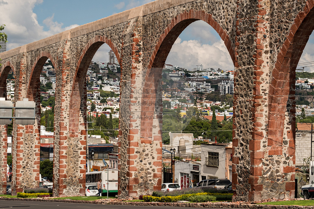 The ancient stone Aqueduct of Queretaro in the old colonial section of Santiago de Queretaro, Queretaro State, Mexico. The aqueduct was completed in 1735 and is the largest in Mexico.
