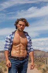 muscular man with open shirt outdoors