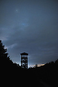 Sightseeing tower in Cape Kolka on cloudy night with minor light pollution in back comming from village, Kolka, Slitere National Park (Slīteres Nacionālais parks), Latvia Ⓒ Davis Ulands | davisulands.com