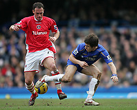 Photo: Lee Earle.<br /> Chelsea v Charlton Athletic. The Barclays Premiership. 22/01/2006. Chelsea's Joe Cole (R) tries to flick the ball past Radostin Kishishev.