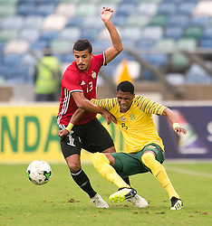 Durban. 080918. Molielo Vincent Pule of South Africa and Mohamed Abdussalam of Libya battles for the the ball during the 2019 Africa Cup of Nations qualifying match between South Africa and Libya at Moses Mabhida Stadiium in Durban,South Africa. Picture Leon Lestrade. African News Agency. ( ANA ).