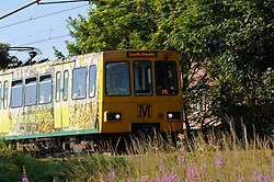 Newcastle Metro: train with Green Forest livery en route to South Shields UK
