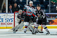 KELOWNA, BC - JANUARY 26: Matthew Wedman #20 of the Kelowna Rockets is checked by Bowen Byram #44 as David Tendeck #30 of the Vancouver Giants defends the net during third period at Prospera Place on January 26, 2020 in Kelowna, Canada. (Photo by Marissa Baecker/Shoot the Breeze)