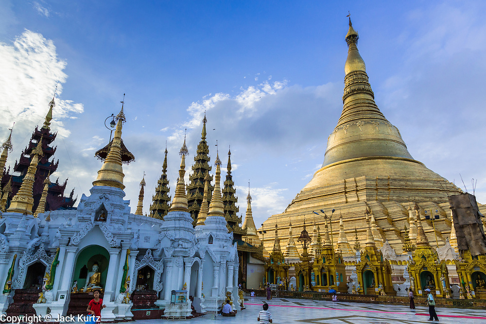 15 JUNE 2013 - YANGON, MYANMAR:   Shwedagon Pagoda is officially known as Shwedagon Zedi Daw and is also called the Great Dagon Pagoda or the Golden Pagoda. It is a 99 meter (325 ft) tall pagoda and stupa located in Yangon, Burma. The pagoda lies to the west of on Singuttara Hill, and dominates the skyline of the city. It is the most sacred Buddhist pagoda in Myanmar and contains relics of the past four Buddhas enshrined: the staff of Kakusandha, the water filter of Koṇāgamana, a piece of the robe of Kassapa and eight strands of hair from Gautama, the historical Buddha. Burmese believe the pagoda was established as early ca 540BC, but archaeological suggests it was built between the 6th and 10th centuries. The pagoda has been renovated numerous times through the centuries. Millions of Burmese and tens of thousands of tourists visit the pagoda every year, which is the most visited site in Yangon. PHOTO BY JACK KURTZ