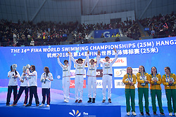 HANGZHOU, Dec. 15, 2018 Members of Team China (C) celebrate during the awarding ceremony of Women's 4x200m Freestyle Relay Final at 14th FINA World Swimming Championships (25m) in Hangzhou, east China's Zhejiang Province, on Dec. 15, 2018. Team China claimed the title with 7:34.08. (Credit Image: © Xinhua via ZUMA Wire)