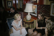 Kylie Minogue and Yasmin LeBon,  Charles Finch and Chanel 7th Anniversary Pre-Bafta party to celebratew A Great Year of Film and Fashiont at Annabel's. Berkeley Sq. London W1. 10 February 2007. -DO NOT ARCHIVE-© Copyright Photograph by Dafydd Jones. 248 Clapham Rd. London SW9 0PZ. Tel 0207 820 0771. www.dafjones.com.