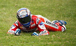 October 21, 2017 - Melbourne, Victoria, Australia - Italian rider Andrea Dovizioso (#4) of Ducati Team slides on the grass after coming off his bike at turn nine during the fourth free practice session at the 2017 Australian MotoGP at Phillip Island, Australia. (Credit Image: © Theo Karanikos via ZUMA Wire)