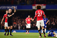 Marouane Fellaini of Manchester United is given a yellow card by referee Anthony Taylor .Premier league match, Chelsea v Manchester United at Stamford Bridge in London on Sunday 5th November 2017.<br /> pic by Andrew Orchard sports photography.