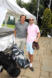 Left to right, THEO FENNELL and JOHNNY VAUGHAN at the Mini Masters Golf tournament in aid of LEUKA - London's first celebrity golf tournament held at Duke's Meadow Golf Club, Dan Mason Drive, London W4 on 14th July 2008.<br /> <br /> NON EXCLUSIVE - WORLD RIGHTS