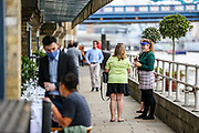 People appear to be having lunch and drinks nearby the River Thames in Central London on Saturday, July 4, 2020. As Britain lifts its Covid-19 Lockdown Measures Pubs reopen today welcoming back customers for the first time in more than three months. (VXP Photo/ Vudi Xhymshiti)