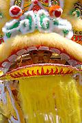 Asian dragon dancer peeping out the mouth. Dragon Festival Lake Phalen Park St Paul Minnesota USA