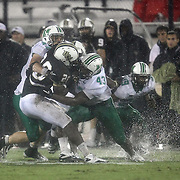 Central Florida running back Latavius Murray (28) gets wrapped up by the Marshall defense during an NCAA football game between the Marshall Thundering Herd and the Central Florida Knights at Bright House Networks Stadium on Saturday, October 8, 2011 in Orlando, Florida. (Photo/Alex Menendez)