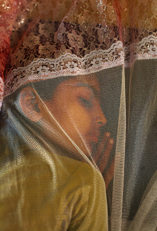 Aleena Ashfaq, 9, sleeps under netting while undergoing treatment for hemophelia inside the Children's Hospital at the Pakistan Institute of Medical Sciences, P.I.M.S., in Islamabad, Pakistan on Sept. 18, 2007.