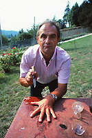 Paul Bocuse playing mumbly peg after drinking<br /> some red wine, in his garden in Collonges, near Lyon - 1983