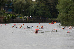 © Licensed to London News Pictures. 31/08/2018. London, UK.  Participants take part in the Tidal River Swim in Hammersmith this evening, launching this years Thames Festival. Over 100 brave enthusiasts took part in a 30 minute swim, as they followed the tide towards Chiswich Eycot and back. Photo credit: Vickie Flores/LNP