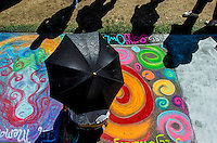Sacramento artist Autumn Hardy, 24 of midtown, works on her project using chalk on the sidewalk during the Chalk It Up event at Fremont Park, Sunday August 31, 2014.<br /> Brian Baer/Special to the Bee