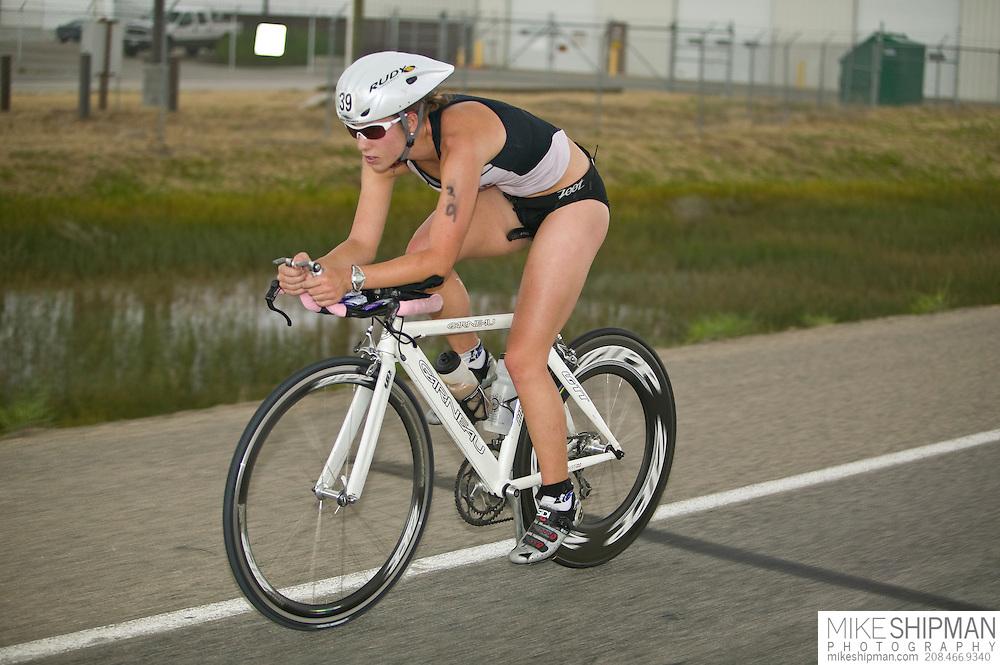 Idaho, Ada County, Boise, Boise 70.3 Ironman, Jennifer Leubke from Missoula, MT, cycles through Boise toward the desert, She finished with a time of 5:05:51