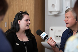 © Licensed to London News Pictures . 11/08/2015 . Merseyside , UK . Adrian Chiles interviews young carer KATIE (20) in the Family Room at Clock View Hospital . BBC Radio 5 Live broadcast live from Clock View mental health Hospital in Merseyside . Photo credit : Joel Goodman/LNP