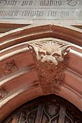 Interior of church of Saint Mary, Halesworth, Suffolk, England, UK - Vestry door dating  15th century carved stonework detail