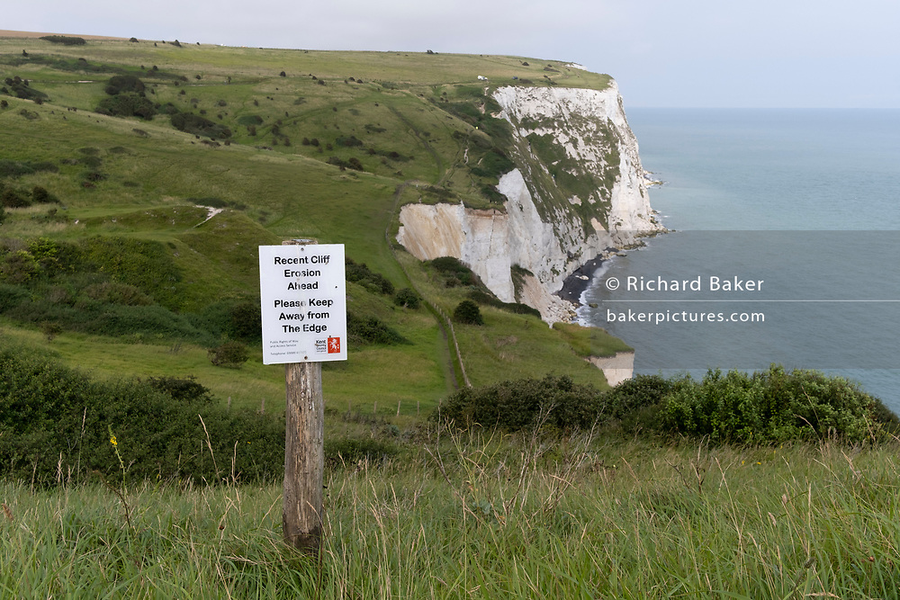 A hilltop landscape of England's iconic White Cliffs, under threat from chalk and soil erosion, on 27th July, at Langdon Bay, Dover, in Kent, England.
