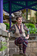 Becky Gillette, stands near a spring on Monday, April 13, 2015, in Eureka Springs, Ark. Gillette is a Sierra Club activist, who is fighting to ban and raise awareness about wood products containing formaldehyde.