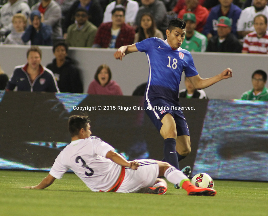 United States' Mario Rodriguez #18 and Mexico'sLouis Solorio #3 fight for a ball during a men's national team international friendly match, April 22, 2015, at StubHub Center in Carson, California. United States won 3-0.  (Photo by Ringo Chiu/PHOTOFORMULA.com)